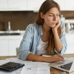 Credit report blog Casual woman looking at laptop