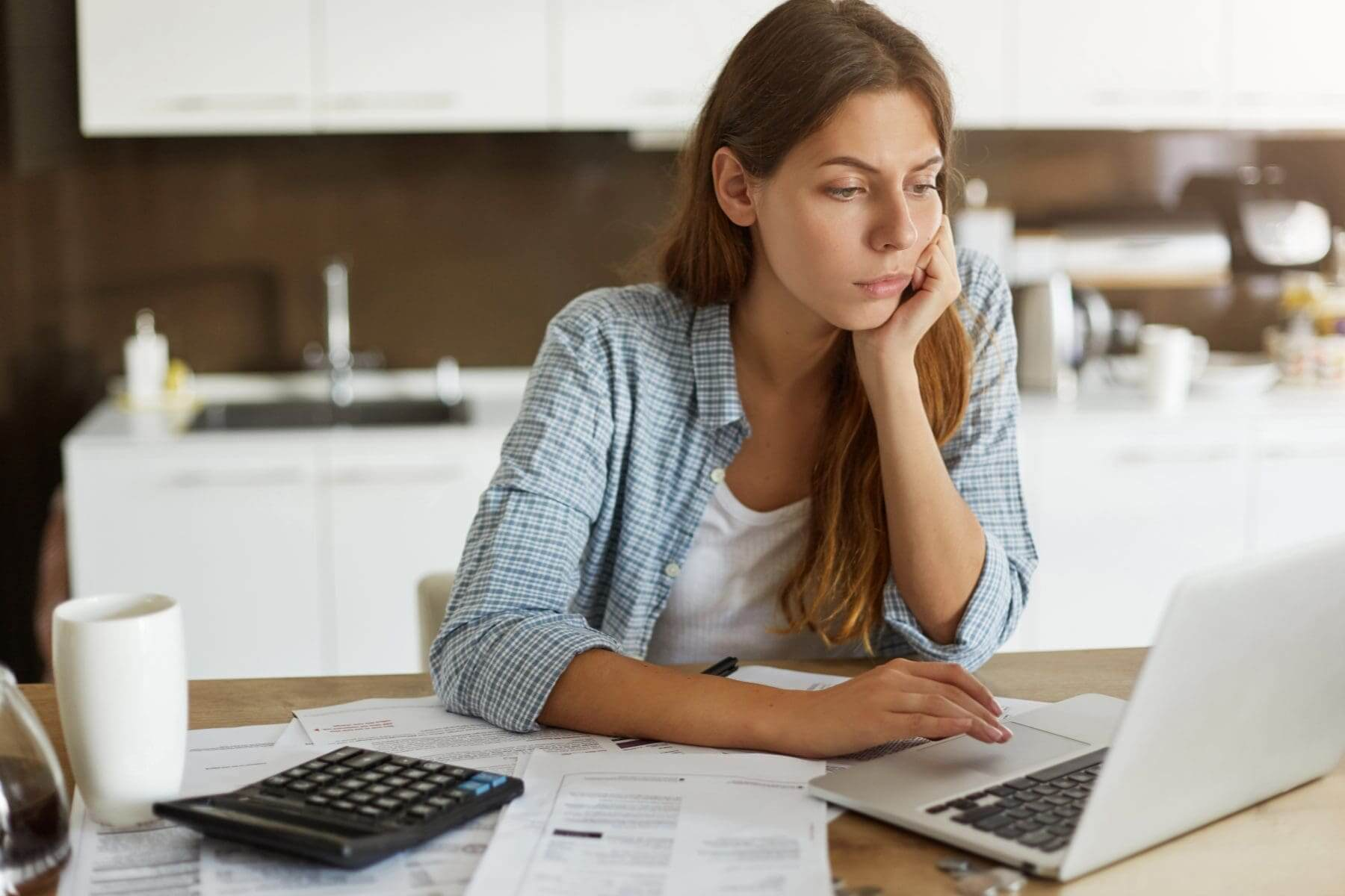 Credit report blog Casual woman looking at laptop